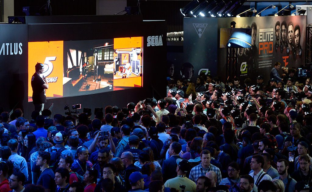 LOS ANGELES, CA - JUNE 14: Gamers look at an ew Atlus video game in the Saga booth during the annual E3 2016 gaming conference at the Los Angeles Convention Center on June 14, 2016 in Los Angeles, California. The Electronic Entertainment Expo will run from June 14 -16. (Photo by Kevork Djansezian/Getty Images)